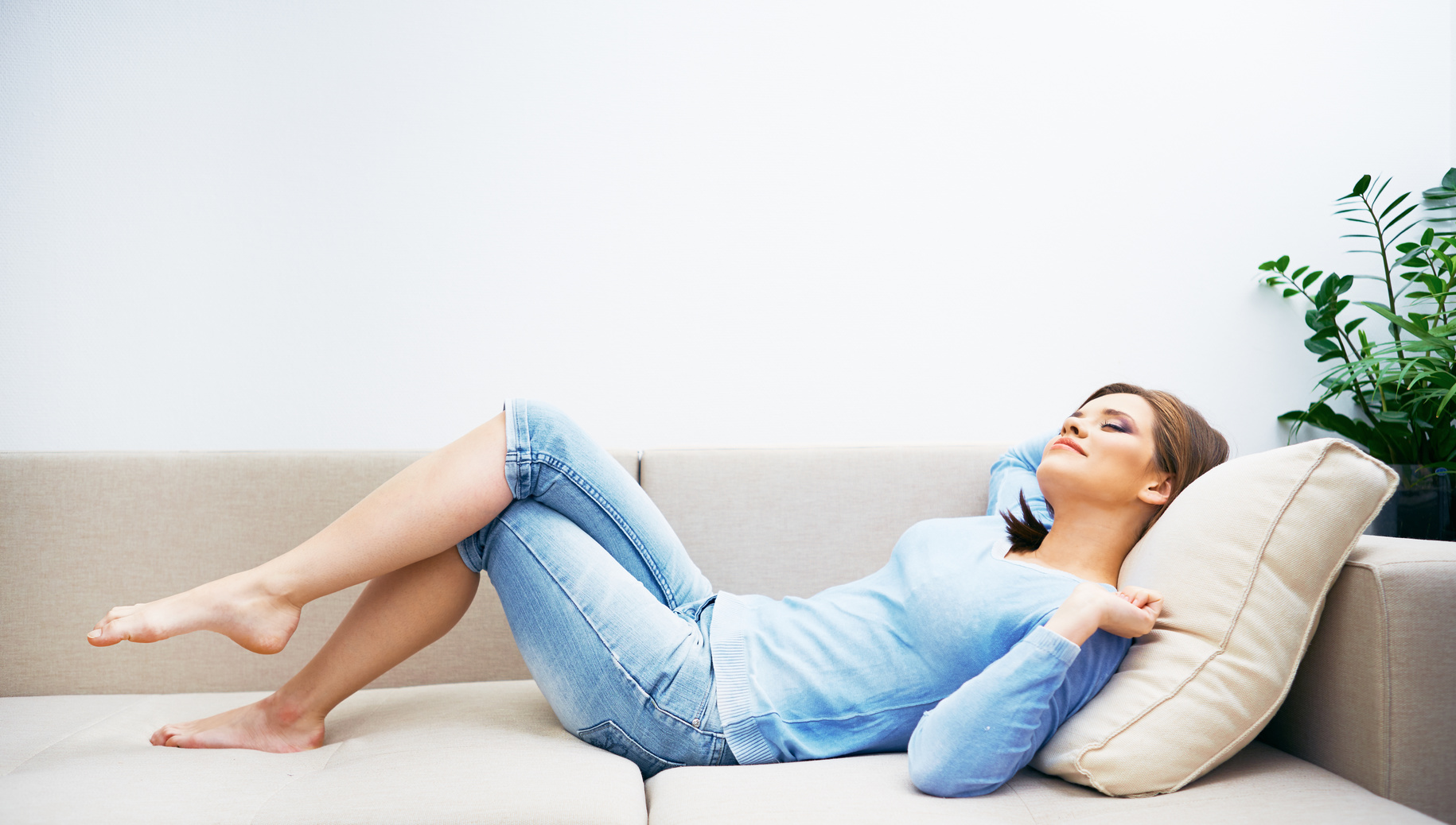 Woman relaxing at home.